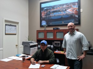 Marcos Herrera (left) signs lease with Tyler Shuff (right)